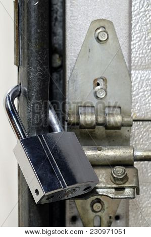 Locked Chrome Padlock. Close Up Vertical Image.