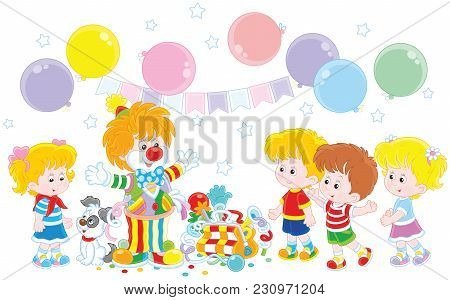 Friendly Smiling Circus Clown In A Colorful Suit With His Pup, Toys And Balloons Playing With Small