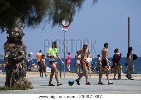 Barcelona , Spain - July, 30. Three Boys With Ball On A  Beach On July, 30 Barcelona , Spain - . Mai