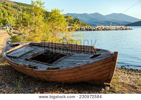 Abandoned Wooden Boat At A Sea Shore Near Mt Pelion In Thessaly, Greece