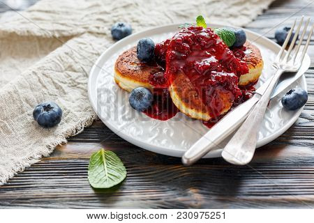 Cottage Cheese Pancakes And Blueberries In Plate On A Wooden Table, Selective Focus.