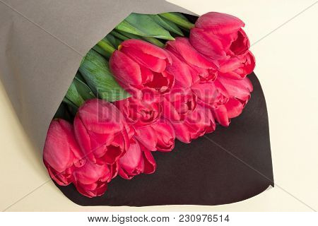 Large Bouquet Of Pink Tulips In Gray Black Wrapping Paper