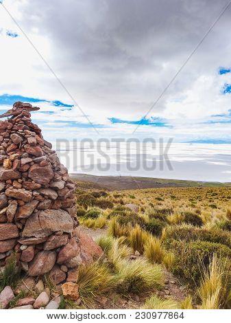 Salar De Uyuni Bolivia Salt Lake With Rock Stacks In Foreground