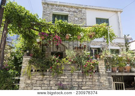 Old Mountain Village Of Pano Lefkara. Cyprus. Ancient Stone House, Twined With Grapes And Decorated