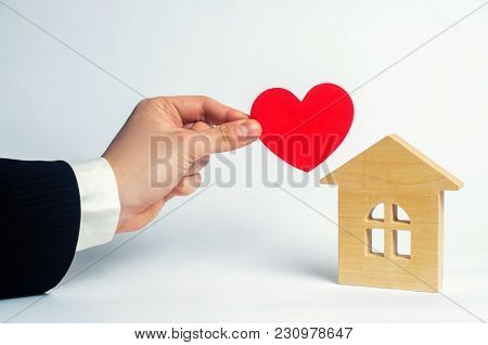 The Man's Hand Holds The Heart And The House . House Of Lovers. Affordable Housing For Young Familie