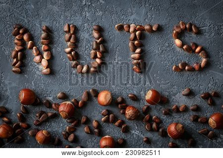 Background Of Mixed Nuts,  Hazelnuts, Pine Nuts. Top View Of Mixed Colorful  Superfoods