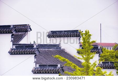 The Walls And Rooftops Of Various Buildings Within The Classical Chinese Li Yuan Garden In Zhaojialo