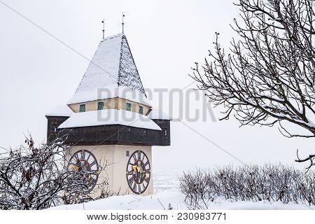 Snow Covered Uhrturm Clocktower Landmark Of City Graz On Hill Schlossberg In Winter