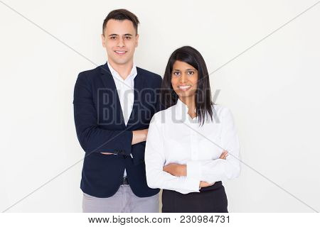 Portrait Of Successful Young Multiethnic Businessman And Businesswoman, Indian Woman And North Ameri
