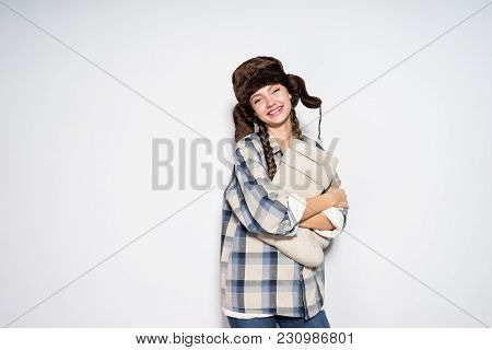 A Smiling Young Woman From Russia Is Waiting For Winter, On Her Head A Warm Fur Hat