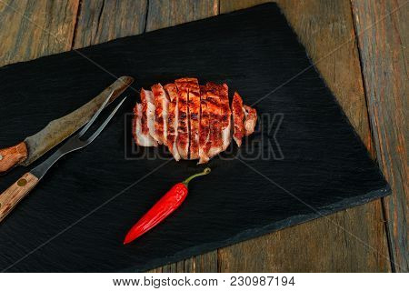 Delicious Steak Medium Roasted With Herbs And Pepper. Sliced Medium Rare Grilled Steak On Rustic Cut