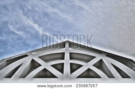 Architectural Building Front With Cloudy Sky Overhead