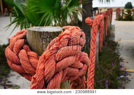 Orange Nautical Rope On Wood Poles As Partition