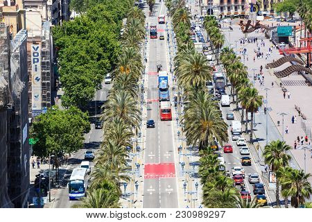 Barcelona, Spain - May 27, 2016: People Crossing The Street. Passeig De Colom, Barcelona