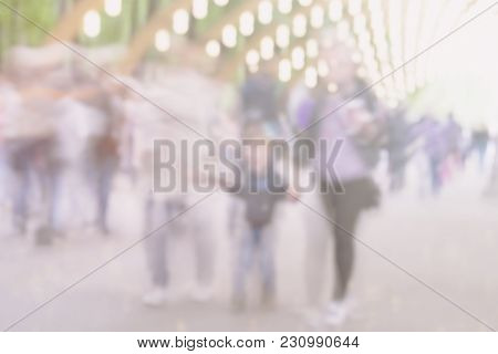 Walking Unrecognizable Happy Family Silhouettes With Child In Park. Blurred Abstract Image For Creat