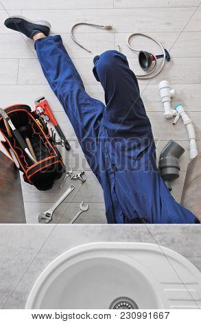 Professional plumber fixing kitchen sink