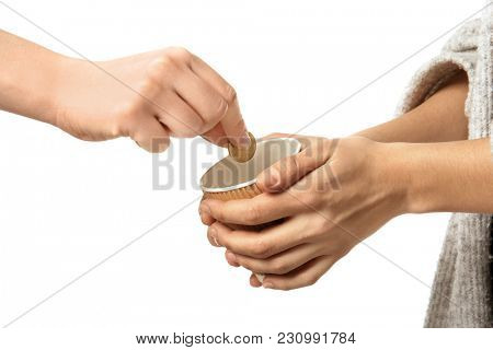 Woman putting coin into cup in hands of female beggar, isolated on white