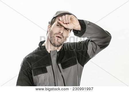 Portrait Close-up Of An Expressive Man With Workwear On Isolated Background