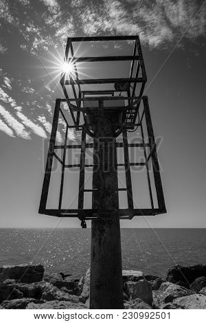 Rusty Beacon Light At The Sea In Black And White