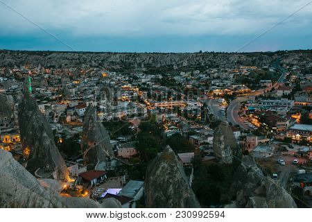 A Small Authentic City Called Goreme In Cappadocia In Turkey. Dramatic Night Sky. Sunset