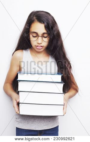 Image Of A Beautiful African Young Girl Wearing Glasses And Holding Books