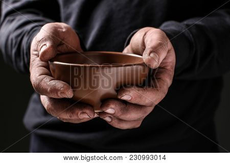 Poor man with bowl begging for money, closeup