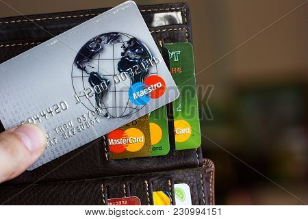 Ryazan, Russia - February 27, 2018: Credit Card Of Maestro Brand Over The Leather Wallet And Number