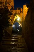 Narrow street of Old Jaffa, Tel-Aviv at night. Middle East. poster