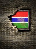 3d rendering of a Gambia flag over a rusty metallic plate embedded on an old brick wall poster