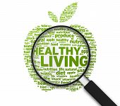 Magnified Apple with the words Healthy Living on white background. poster