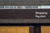 Recession Image Of A 1970s Style Grim Urban Rundown British Shopping Precinct Sign poster