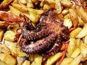 Octopus with potato baked in olive oil - traditional Dalmatian dish poster