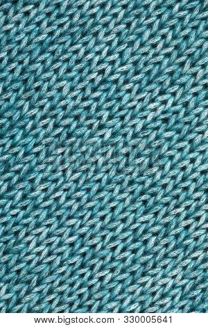 Green Textured Knitted Background.close Up Of Wool Fabric Texture.