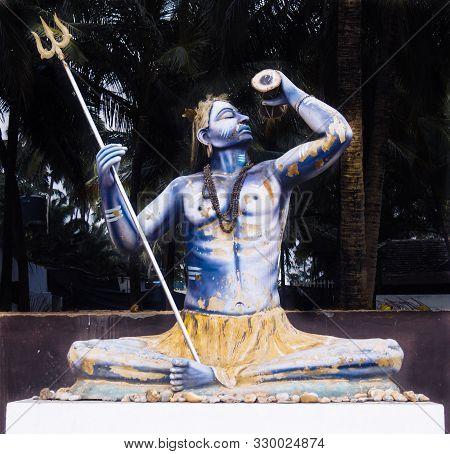 Worn Out Old Idol Of A Hindu God Lord Shiva Placed Somewhere In Anjuna Beach, Goa, India