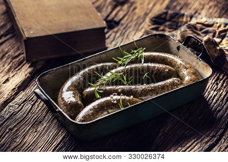 Roasted Sausages In Pan With Rosemary. Traditional European Food Bratwurst Jaternice Or Jitrnice