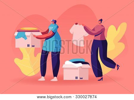 Selfless Kind Women Volunteers In T-shirts With Emblem Of Charity Organization Collecting Clothes Fo