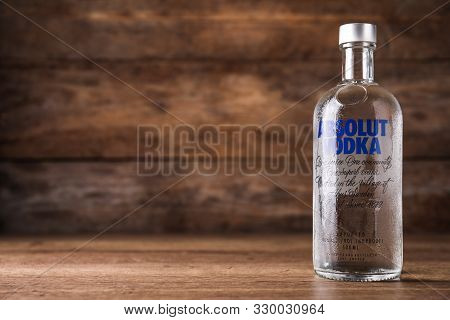 Mykolaiv, Ukraine - October 04, 2019: Absolut Vodka On Table Against Wooden Background. Space For Te