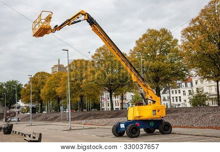 Aerial Work Platform With Articulated Boom, Yellow Color Industrial Machinery, Rotterdam, Netherland