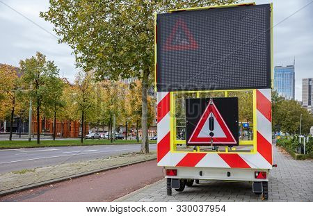Roadworks Warning Signage, Led Lights Board And Danger Exclamation Traffic Sign On A Trailer In The