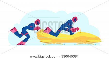 Wintertime Sledding Sport. Men Bobsleigh Team Pushing Bob And Sliding Downhills During Winter Olympi