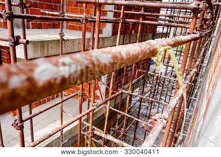 Scaffold Is Placed Against Edifice, Building Under Construction.