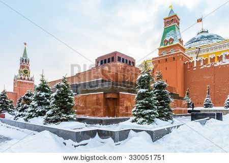 Moscow Red Square In Winter, Russia. Lenin's Mausoleum By Moscow Kremlin Under Snow.
