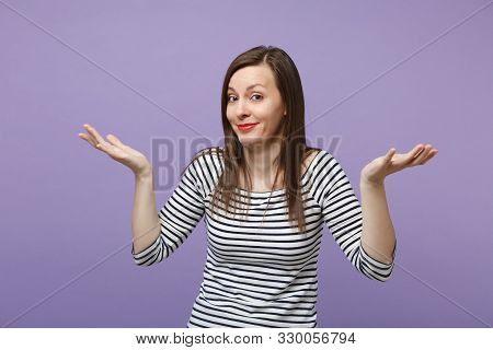 Smirked Mocking Young Brunette Woman Girl In Casual Striped Clothes Posing Isolated On Violet Purple