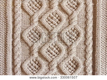 Background Texture Knitted Canvas With Patterns Aran Closeup Light Beige Color