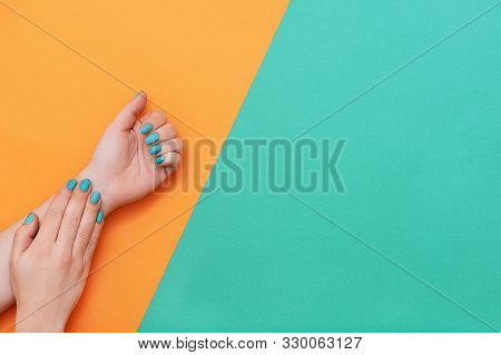 Perfect Manicure With Trendy Nail Art On Orange And Turqoise Background With Copy Space.