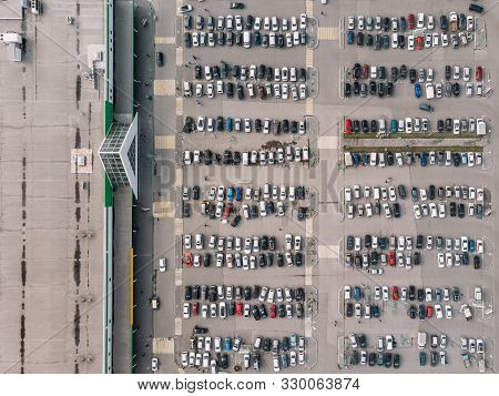 Photo Of Hundreds Car Parked Near Mall. Large Stores Stimulate Increased Excessive Consumption And P