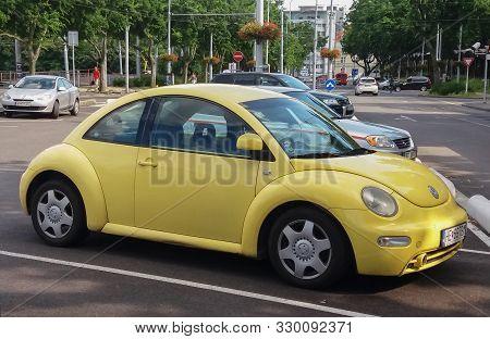 Yellow Volkswagen New Beetle In Bratislava
