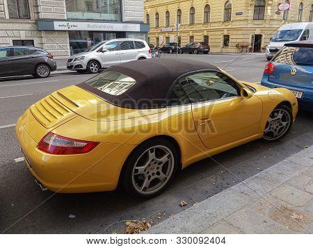 Vienna, Austria - Circa September 2018: Yellow Porsche Boxster 2.7 Sport Chrono Plus Cabriolet Car (