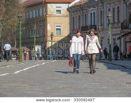 Kaunas, Lithuania - Circa April 2017: Unidentified Girls In The City Centre