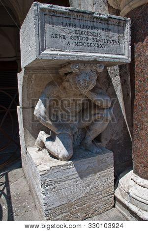 Venice, Italy: Il Gobbo Di Rialto, A Granite Statue Of A Hunchback Found Opposite The Church Of San